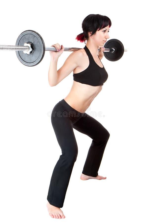 Junge Frau hängen übergibt oben Gewicht lizenzfreies stockbild