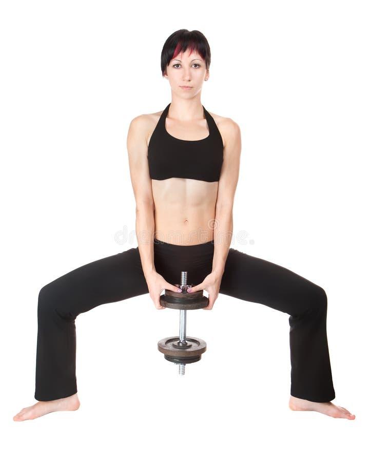 Junge Frau hängen oben hads Gewicht lizenzfreie stockbilder