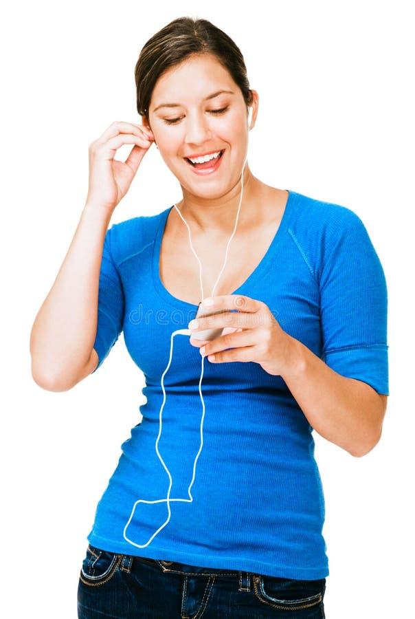Junge Frau hörender mp3 stockbild