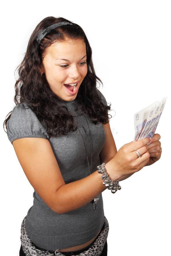 Junge Frau hat viel Geld gewonnen stockbild