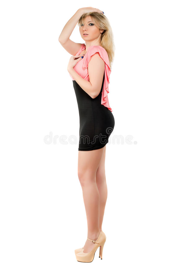 Junge Frau im Cocktailkleid stockbild