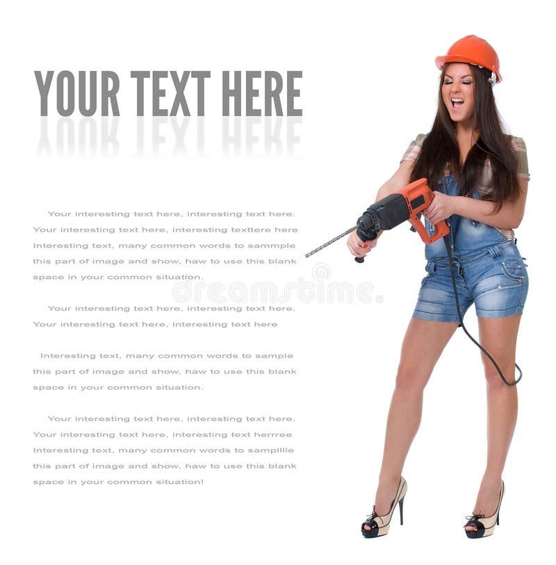 Junge Frau im elektrischen Bohrhammer der Jeanshexe lizenzfreie stockfotografie
