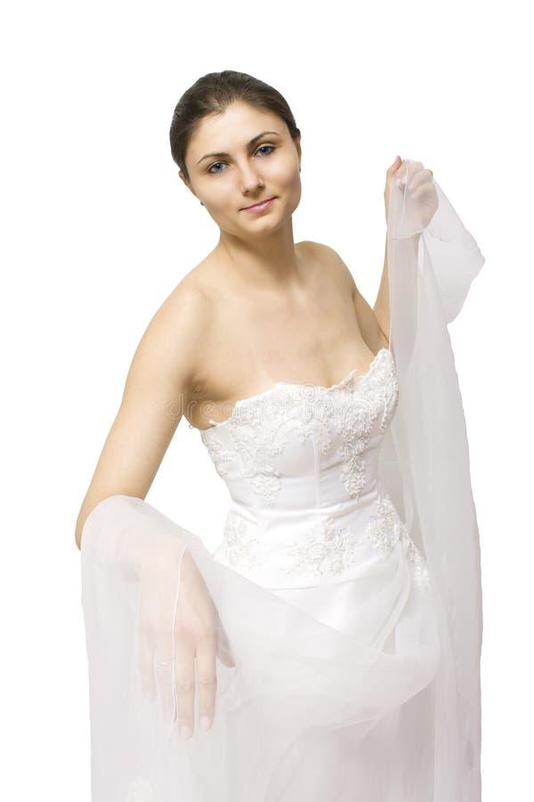 Junge Frau im Hochzeitskleid lizenzfreie stockfotografie