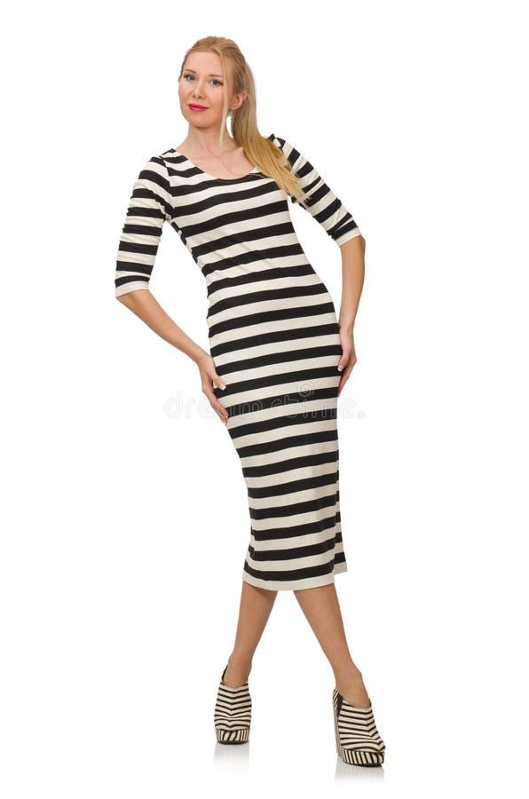 Junge Frau im lang gestreiften Kleid an lokalisiert stockbild
