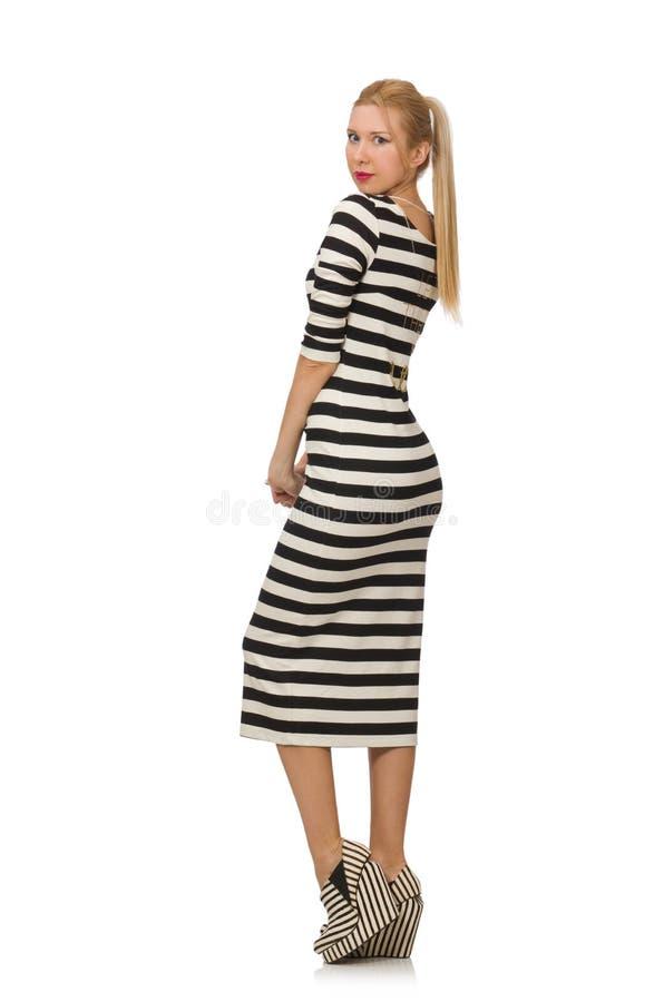 Junge Frau im lang gestreiften Kleid an lokalisiert lizenzfreies stockfoto