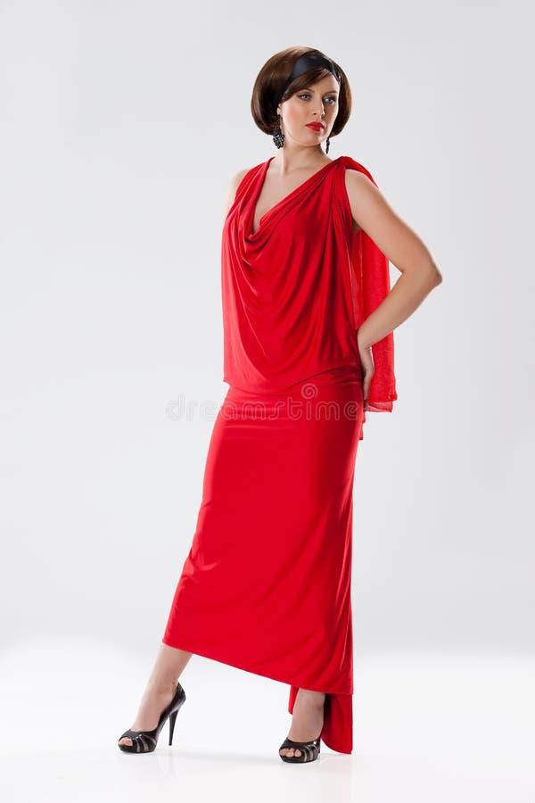 Download Junge Frau im roten Kleid stockbild. Bild von fashion - 12203529