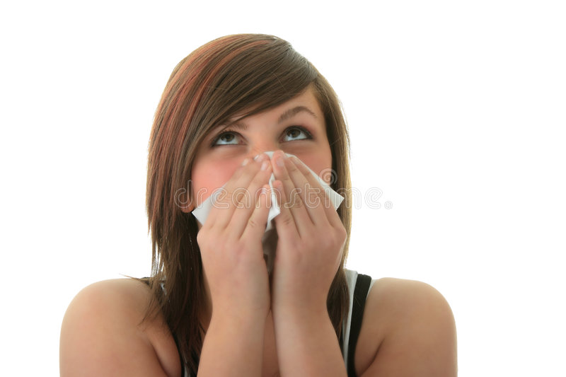 Junge Frau mit Allergie oder Kälte lizenzfreie stockfotografie