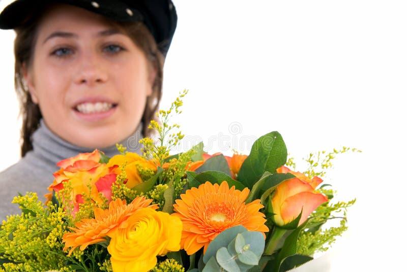 Junge Frau mit Blume lizenzfreies stockbild