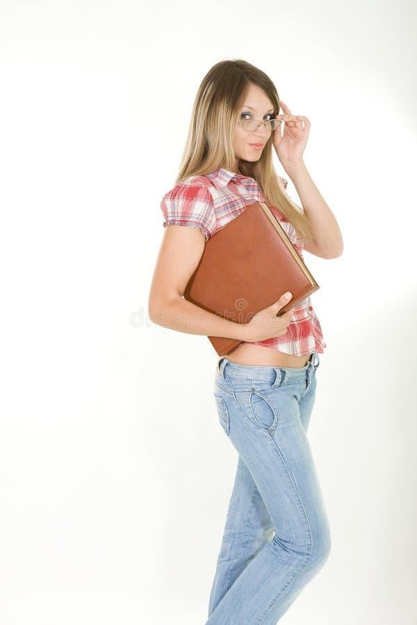 Junge Frau mit Buch stockbilder