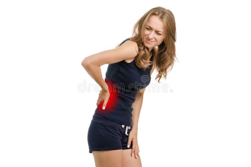 Junge Frau mit den rückseitigen Schmerz lizenzfreies stockfoto
