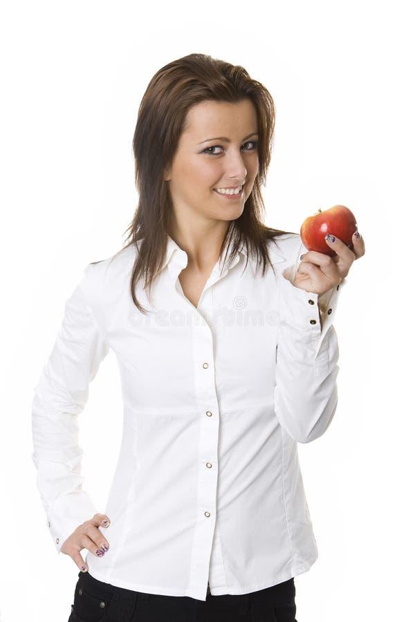 Junge Frau mit einem roten Apfel stockfotos