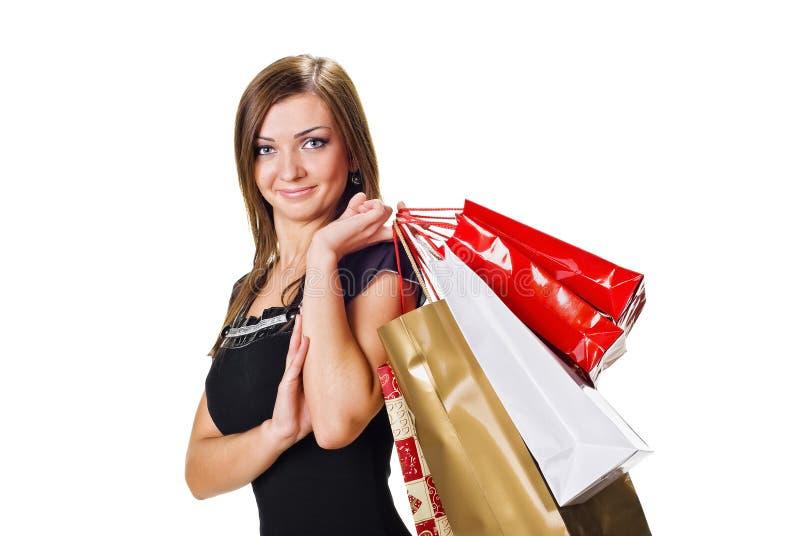 Junge Frau mit Einkaufenbeuteln stockfoto