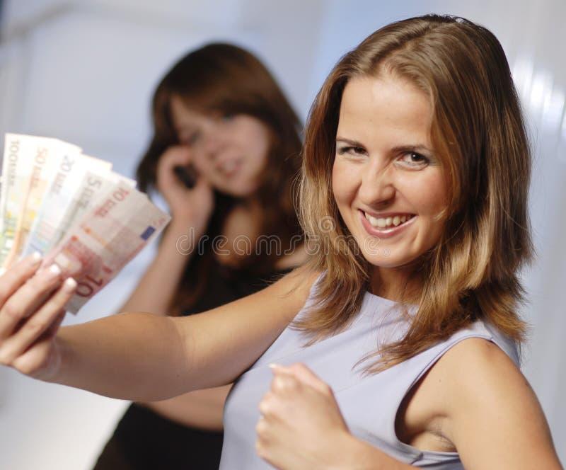 Junge Frau mit Euro stockbild