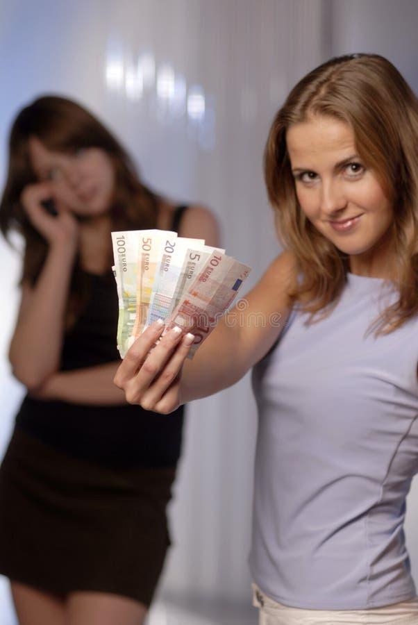 Junge Frau mit Euro stockbilder