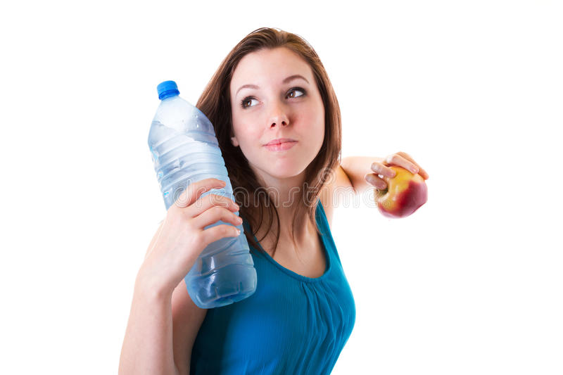 Junge Frau mit Flasche des Wassers und des Apfels lizenzfreies stockbild