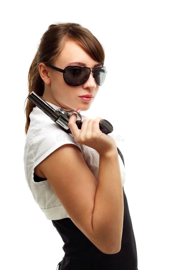 Junge Frau mit Gewehr stockfotografie