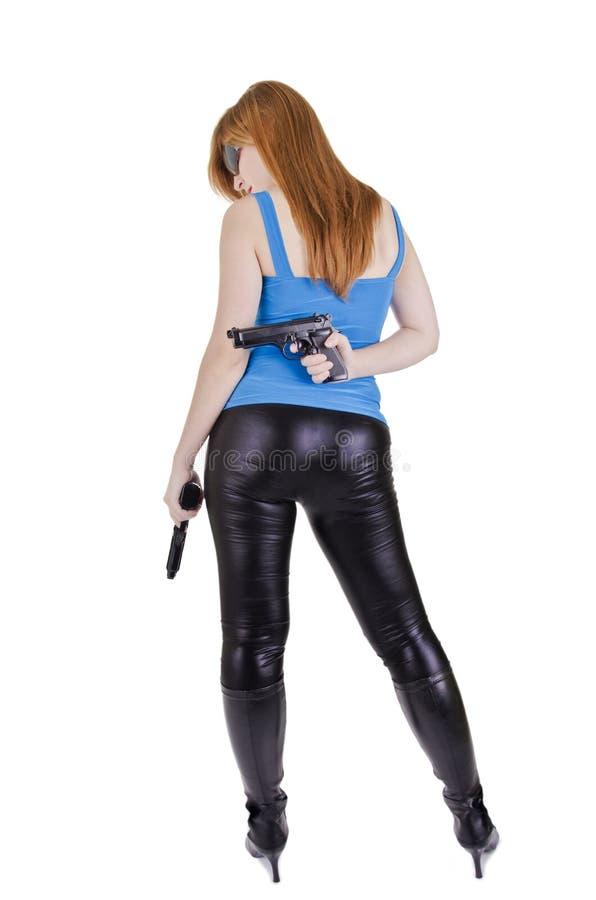 Junge Frau mit Gewehren stockbild