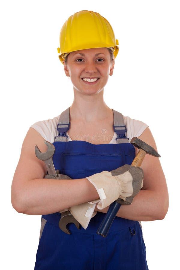 Junge Frau mit Hammer und Zangen lizenzfreie stockfotos