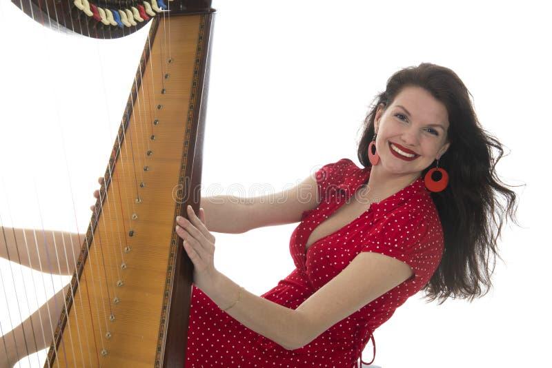 Junge Frau mit Harfe lizenzfreies stockfoto
