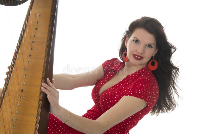 Junge Frau mit Harfe lizenzfreie stockfotografie