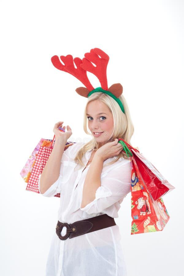 Junge Frau mit Hupen lizenzfreie stockfotos