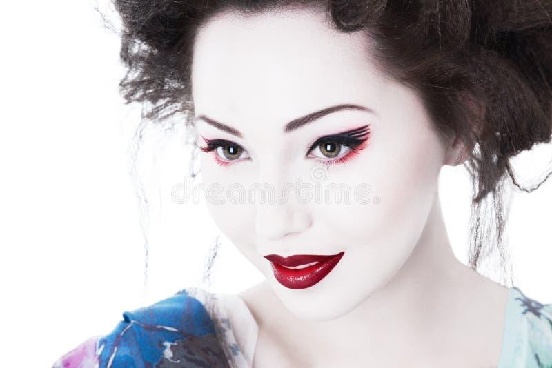 Junge Frau mit klassischem Japan-Artmake-up lizenzfreie stockbilder