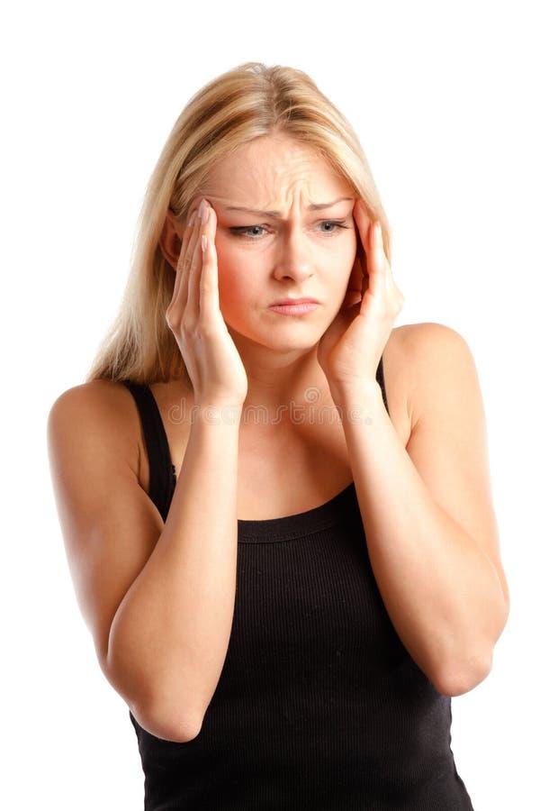 Junge Frau mit Kopfschmerzen stockfotos