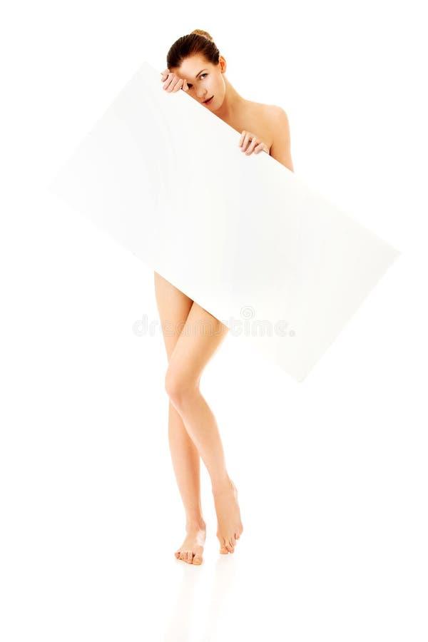 Junge Frau mit leerem Brett lizenzfreies stockfoto