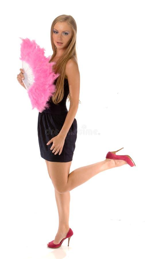 Junge Frau mit rosafarbenem Handgebläse lizenzfreie stockfotos