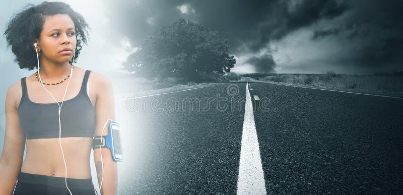 Junge Frau mit Sportkleidung lizenzfreie stockfotos