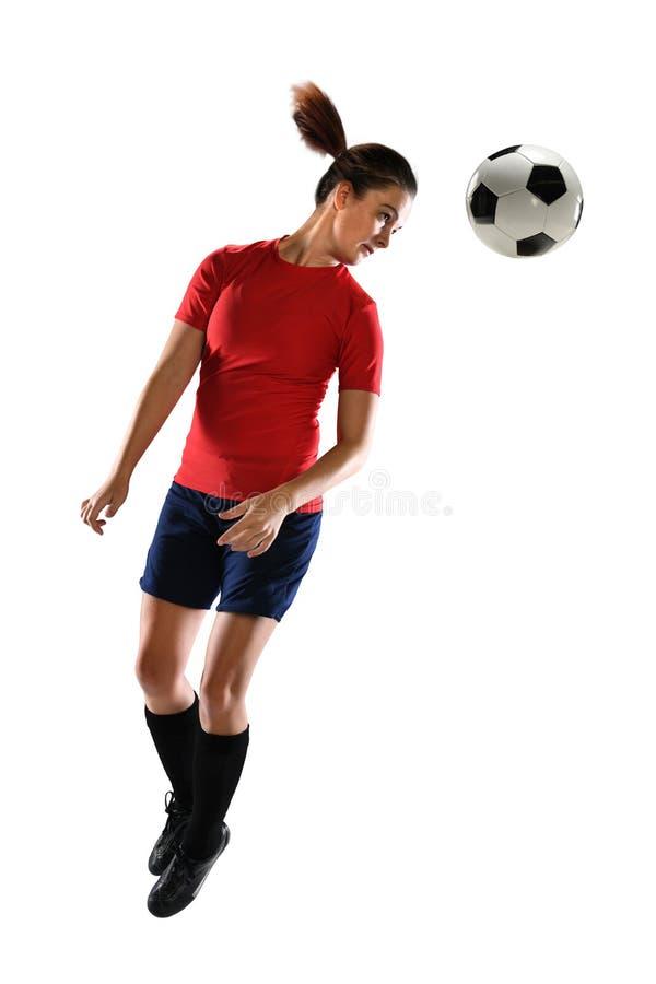 Junge Frauen-Überschrifts-Fußball lizenzfreie stockfotos