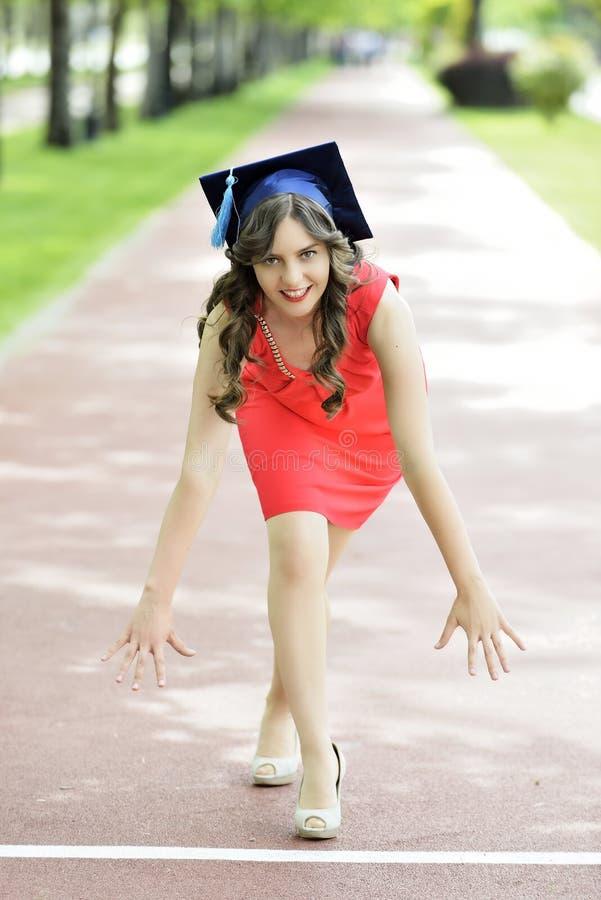 Junge Frauen-Absolvent lizenzfreie stockfotos