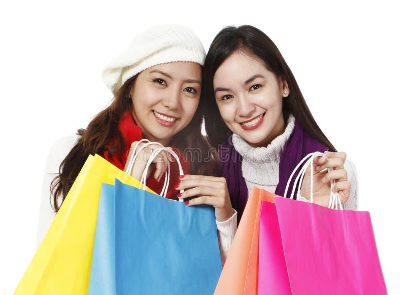Junge Frauen-Einkauf stockfotos
