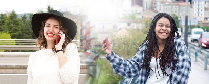 Junge Frauen mit Handy stockfoto
