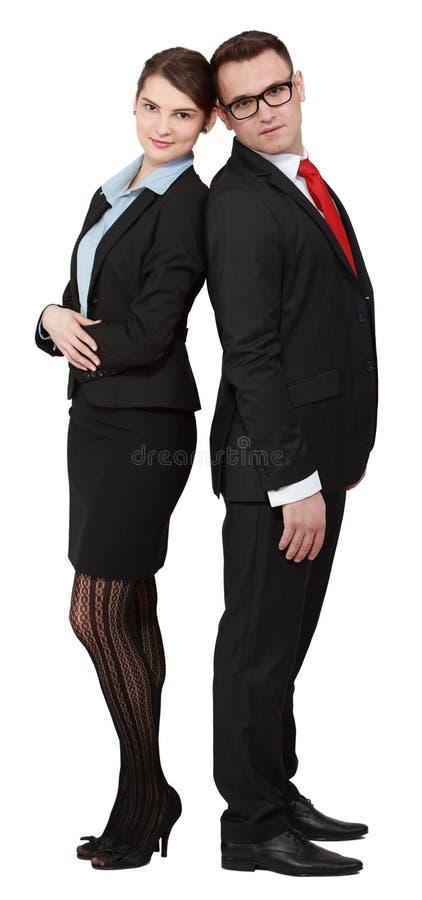 Junge Geschäfts-Paare Ziehen Sich An Zurück Zurück Stockbilder