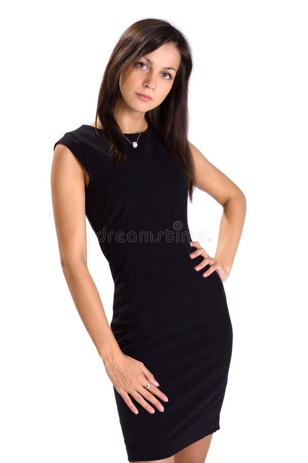 Junge Geschäftsdame im schwarzen Kleid getrennt lizenzfreie stockfotografie