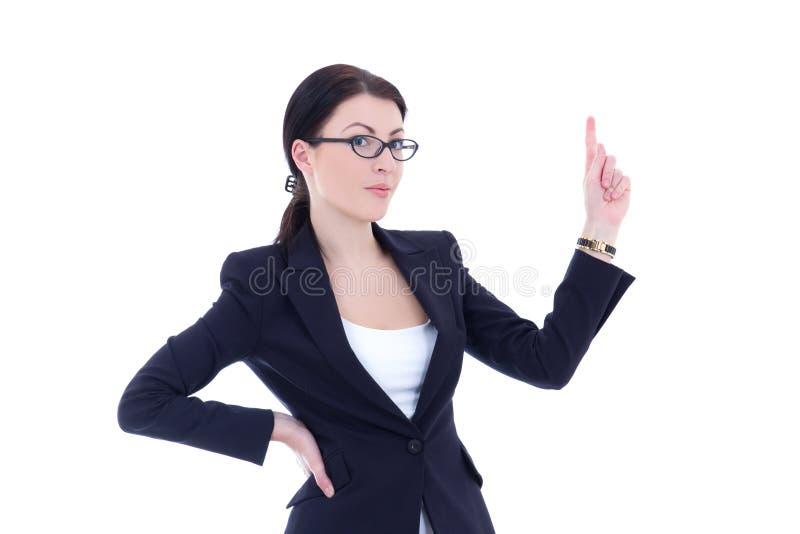 Junge Geschäftsfrau, die auf etwas interessant gegen w zeigt lizenzfreie stockfotos