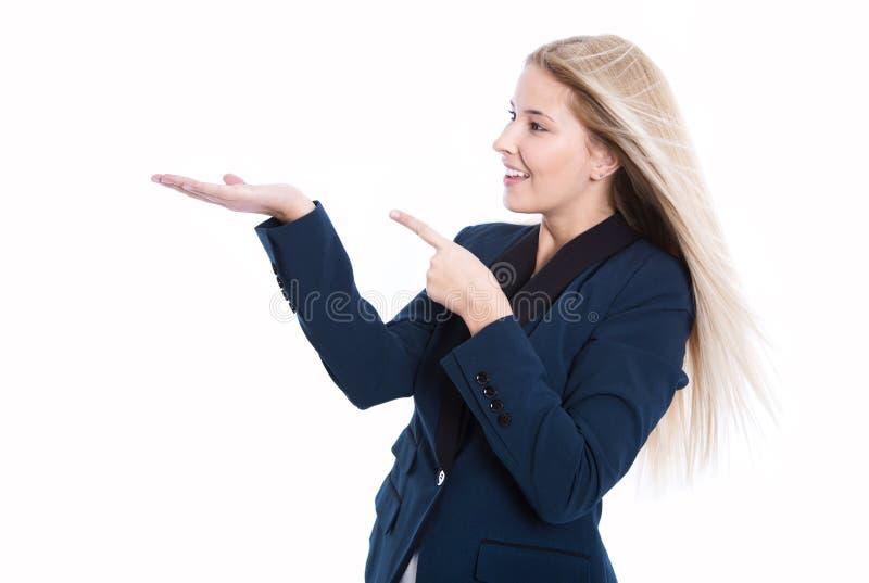 Junge Geschäftsfrau, die mit dem Zeigefinger und Palme lokalisiert sich darstellt stockfotos
