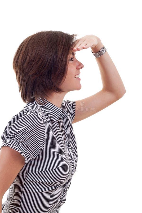 Junge Geschäftsfrau, die vorwärts schaut lizenzfreie stockfotos
