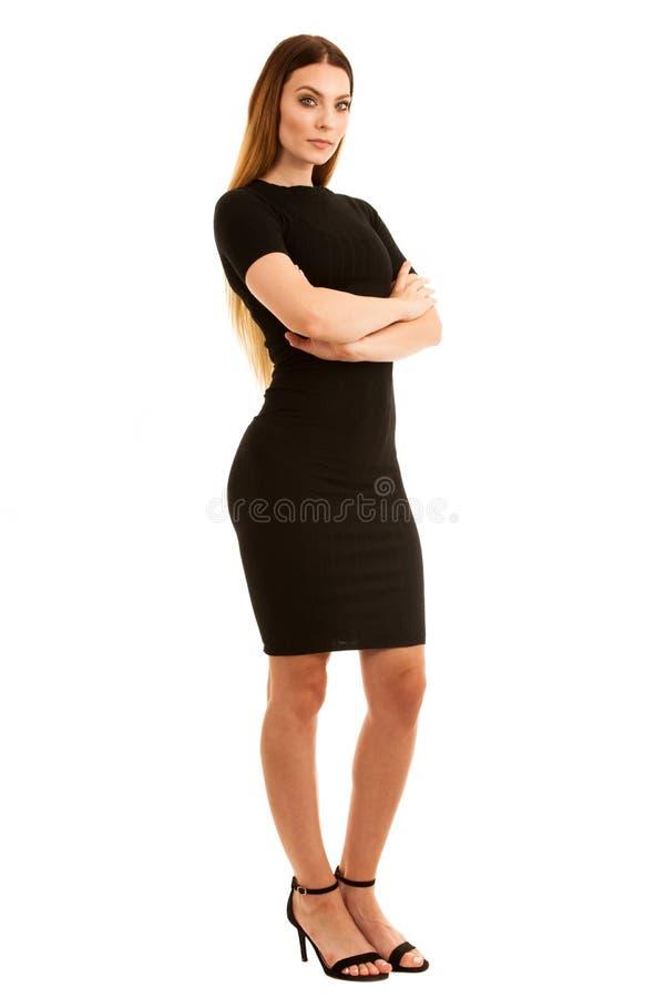 Junge Geschäftsfrau im schwarzen Kleid lokalisiert über weißem backgrou lizenzfreie stockbilder