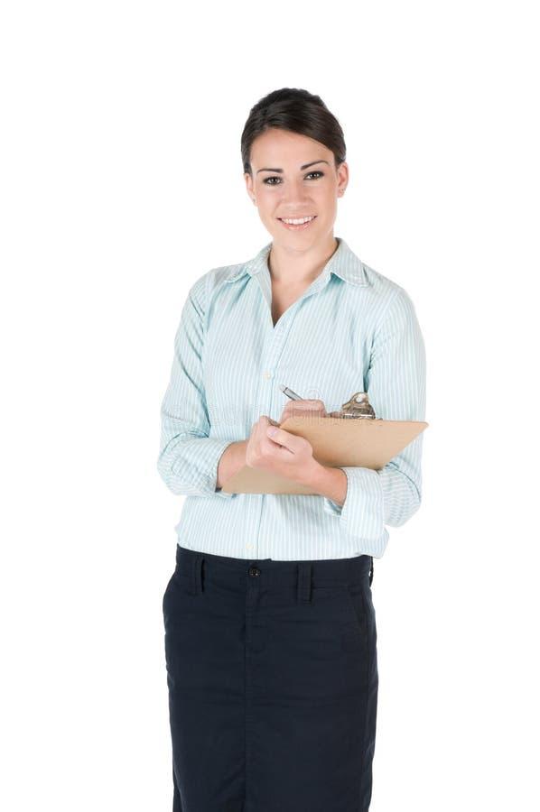 Junge Geschäftsfrau mit dem Klemmbrett, getrennt lizenzfreie stockbilder