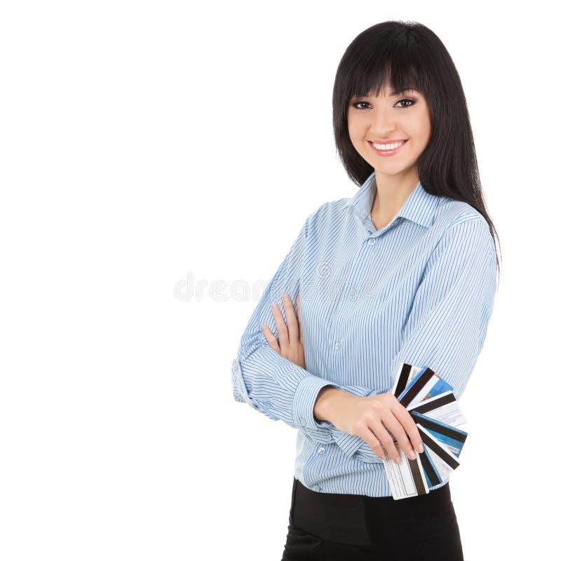 Junge Geschäftsfrau mit Scheckkarten lizenzfreie stockfotos