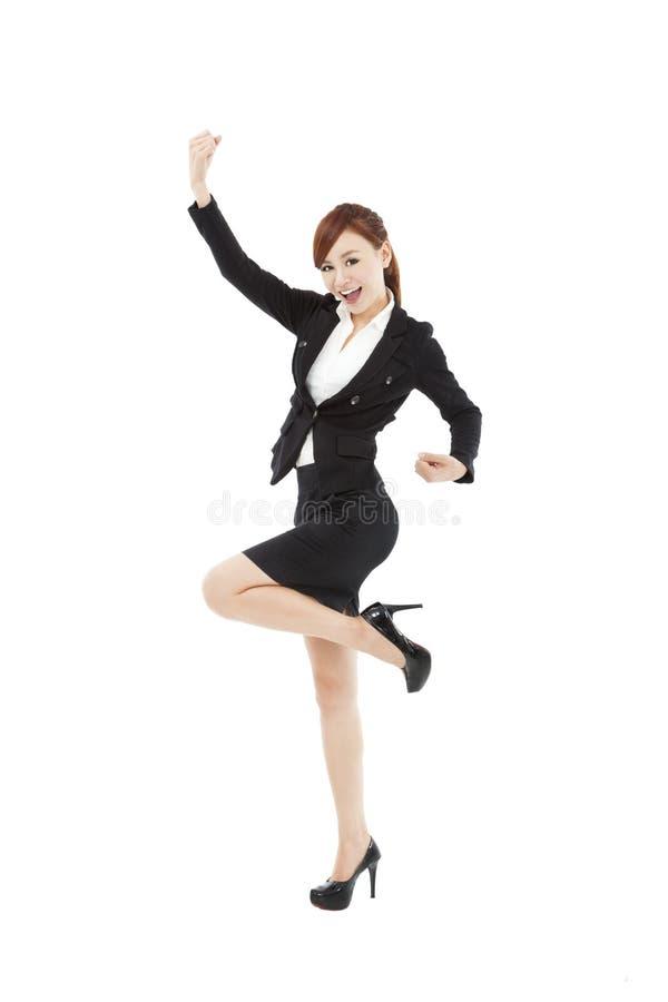 Junge Geschäftsfrau mit Erfolgsgeste stockfotos