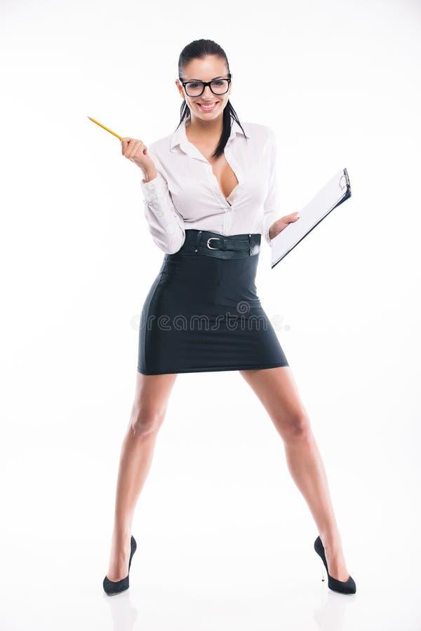 Junge Geschäftsfrau mit Form und Bleistift lizenzfreie stockfotografie
