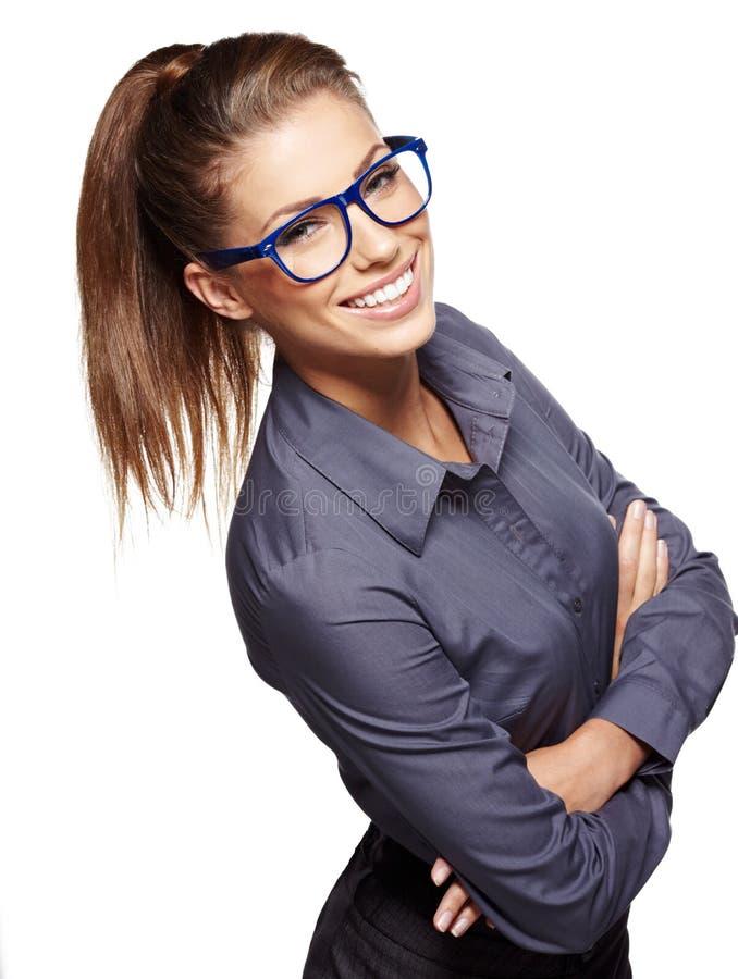 Junge Geschäftsfrau mit Gläsern stockfotos