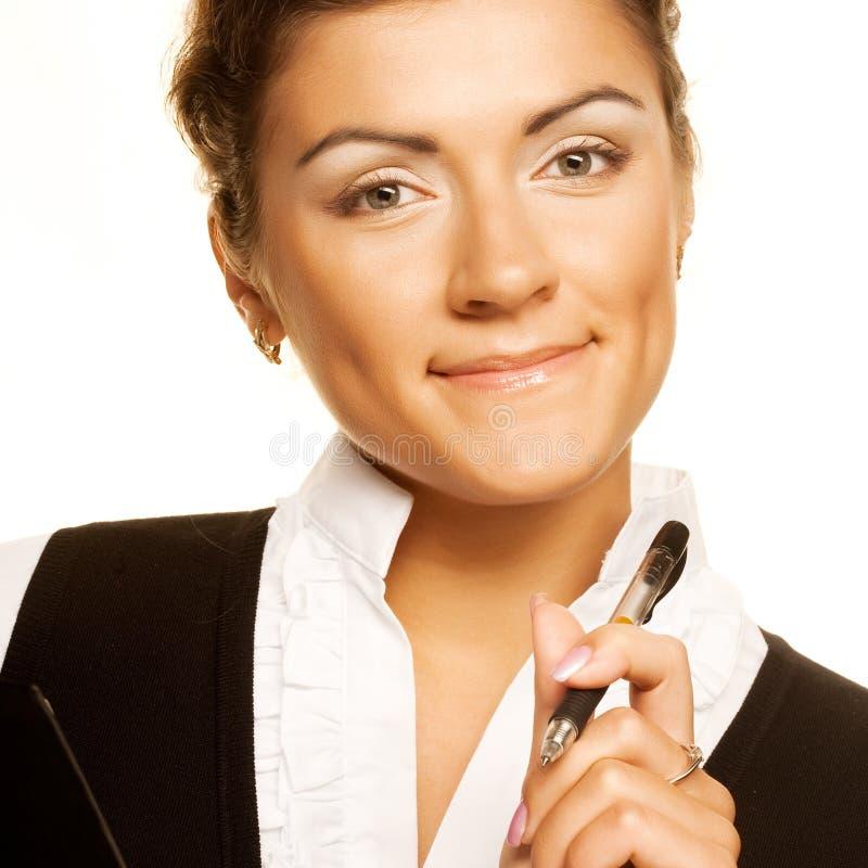 Junge Geschäftsfrau schreiben. lizenzfreie stockfotografie