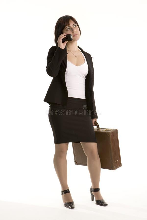 Junge Geschäftsfrau am Telefon lizenzfreies stockbild