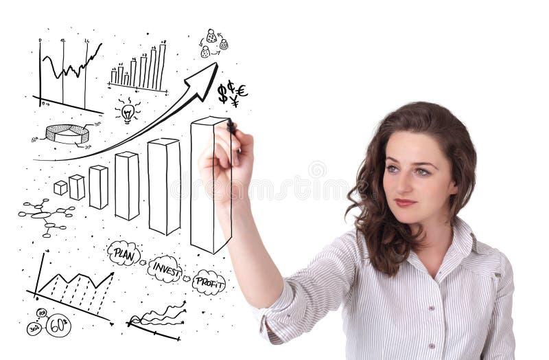 Junge Geschäftsfrau-Zeichnungsdiagramme auf whiteboard lizenzfreies stockbild