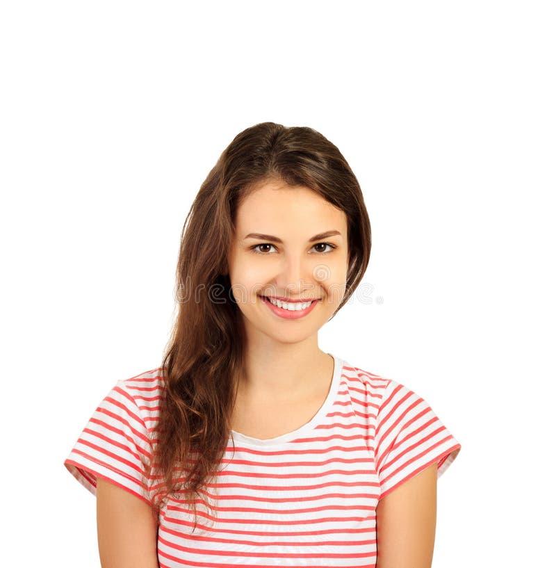 Junge glückliche lächelnde Frau mit dem langen braunen gelockten Haar emotionales Mädchen lokalisiert auf weißem Hintergrund lizenzfreies stockfoto