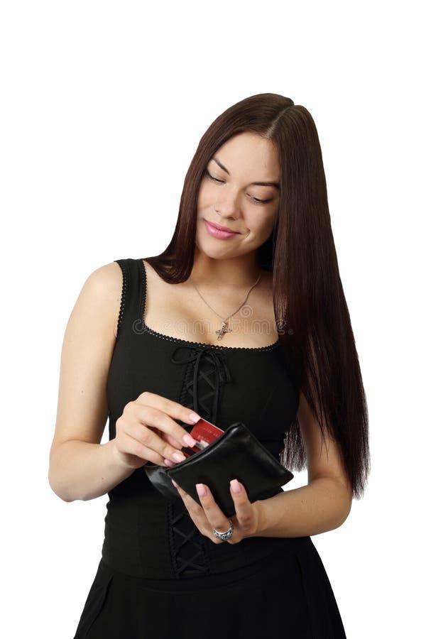 Junge hübsche Frau mit Geldbeutel in den Händen lizenzfreie stockfotos